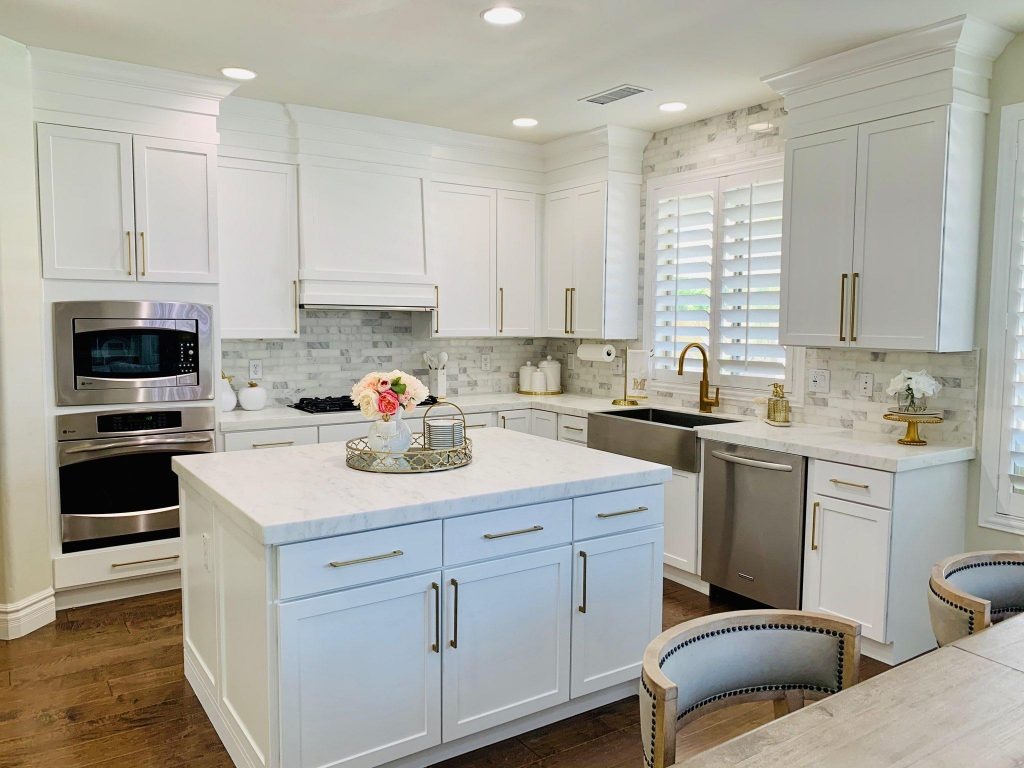 White kitchen cabinets and gold hardware